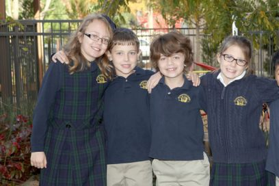 Four students in school uniforms.