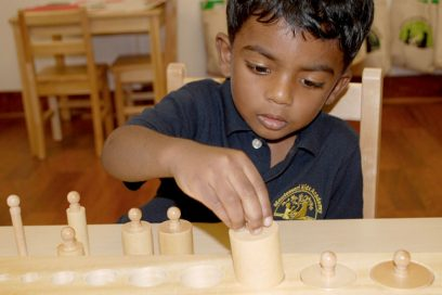 boy doing a learning activity with wood toy