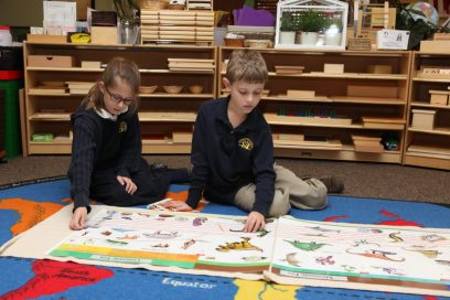 Two elementary aged students working together.