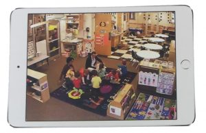 An ipad screen showing a preschool classroom.