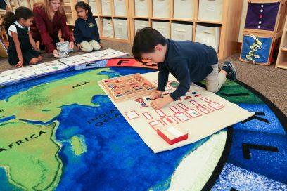 child doing montessori letter activity