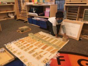 boy doing learning activity on floor