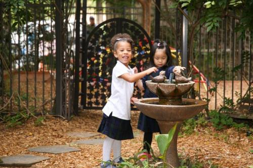 girls in daycare playing outside