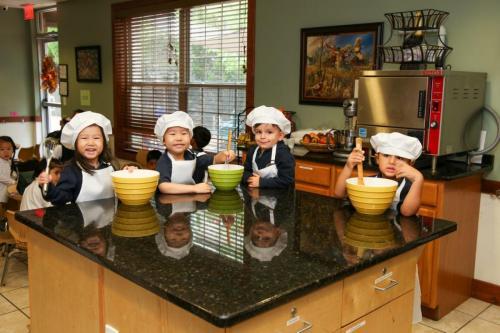 preschool children in chef's hats