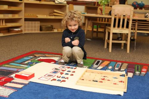 child in daycare learning