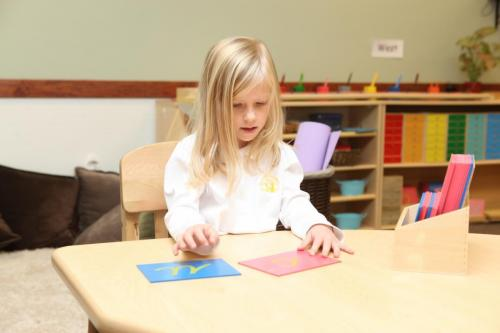child doing learning activity